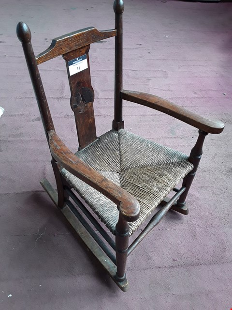 Lot 17 ANTIQUE OAK CHILD'S ROCKING CHAIR WITH RUSH SEAT & INLAID SPLAT