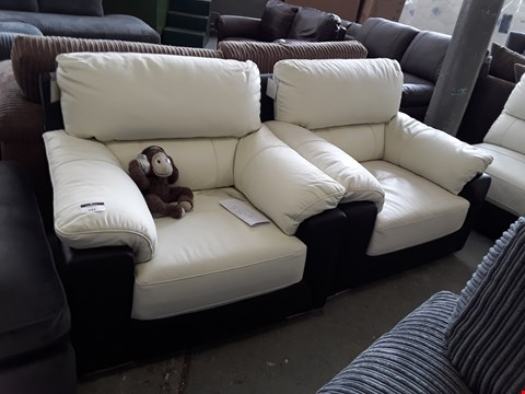 Lot 143 TWO DESIGNER TWO TONE CREAM AND BLACK FAUX LEATHER ARMCHAIRS