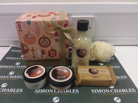 Lot 194 THE BODY SHOP NUTTY & NOURISHING SHEA FESTIVE PICKS SET INCLUDING BODY BUTTER, SOAP AND SHOWER CREAM