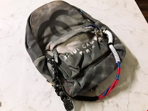 Lot 596 DOLCE AND GABBANA STYLE DISTRESSED LOOK BACKPACK