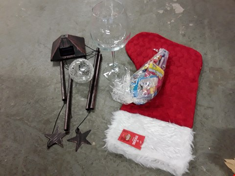 Lot 2471 LOT OF 4 ASSORTED GRADE 1 ITEMS TO INCLUDE SUN MOON & STARS WINDCHIME AND LIGHT, LARGE GIN GLASS, PERSONALISED CHRISTMAS SWEETIE STOCKING RRP £86