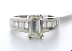 Lot 23 18CT WHITE GOLD SINGLE STONE CLAW SET EMERALD CUT WITH STONE SET SHOULDERS DIAMOND RING RRP £93500