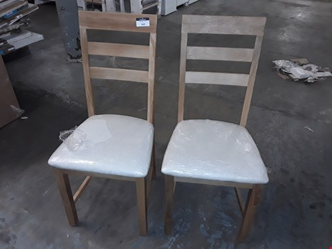 Lot 569 LOT OF 2 LIGHT OAK EFFECT DINING CHAIRS WITH NATURAL SEAT PADS