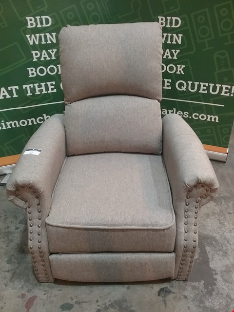 Lot 67 DESIGNER GREY FABRIC RECLINING ARM CHAIR WITH STUDDED ARM DETAIL