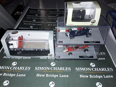 Lot 612 LOT OF 4 ASSORTED COLLECTABLE MODEL VEHICLES TO INCLUDE OXFORD COMMERCIALS BROMZE GREEN LAND ROVER, FORMULA 1 STIRLING MOSS' COOPER T51-1959, GRAHAM HILL LOTIS 498- 1960 ETC