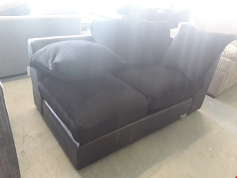 Lot 32 DESIGNER BLACK FAUX LEATHER AND BLACK FABRIC SOFA