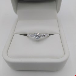 Lot 13 18CT WHITE GOLD SOLITAIRE RING SET WITH A BRILLIANT CUT DIAMOND AND BAGUETTES, TOTAL WEIGHT 0.65CT RRP £3750.00