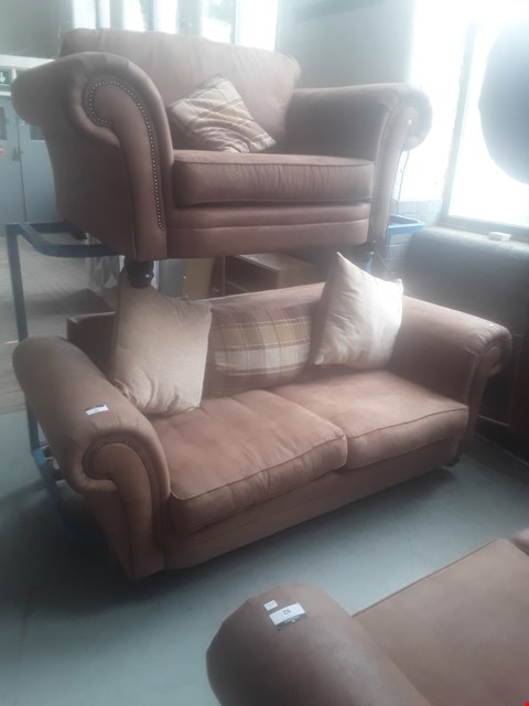 Lot 93 DESIGNER TAN SUEDE STUDDED SCROLL ARM SUITE, COMPRISING, THREE SEATER SOFA & SNUGGLE CHAIR WITH SCATTER CUSHIONS