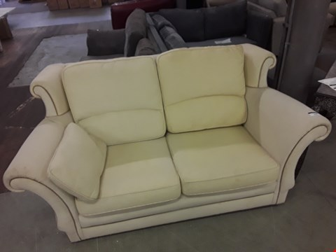 Lot 82 CREAM FABRIC TWO SEATER SCROLL ARMED SOFA