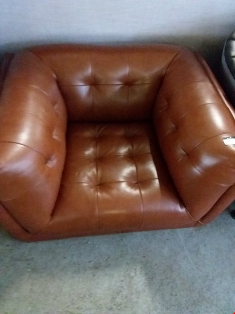 Lot 50 DESIGNER TAN FAUX LEATHER RETRO CHAIR