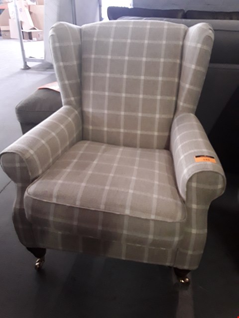 Lot 145 QUALITY BRITISH DESIGNER HIGHLAND CREAM/NATURAL CHECK FABRIC WINGED EASY CHAIR ON BRASS CASTORS