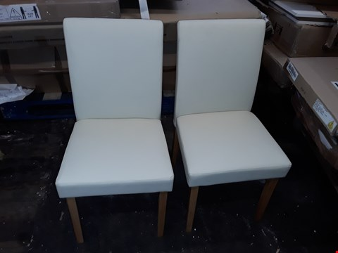 Lot 7012 2 CREAM FAUX LEATHER DINING CHAIRS
