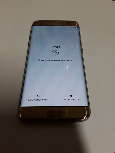 Lot 595 SAMSUNG GALAXY S7 EDGE 32GB MOBILE PHONE - GOLD