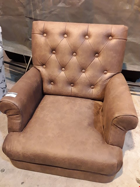 Lot 10 DESIGNER DISTRESSED BUTTONED TAN FAUX LEATHER EASY CHAIR