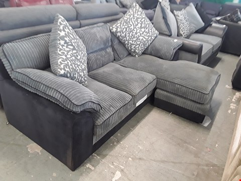 Lot 83 DESIGNER BLACK FABRIC AND GREY JUMBO CORD CHAISE SOFA