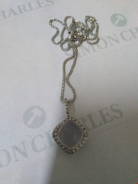 Lot 33 18CT WHITE GOLD PENDANT ON CHAIN SET WITH A QUARTZ TO A DIAMOND HALO RRP £3600.00