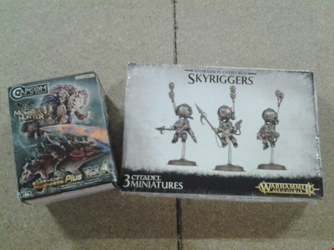 Lot 394 2 ASSORTED PRODUCTS TO INCLUDE; WARHAMMER KHARADON OVERLORDS SKYRIGGERS AND CAPCOM MONSTER HUNTER