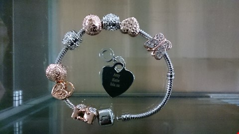 Lot 1492 A SET OF APROX. 7 PERSONALISED ROSE GOLD CHARM BARCALET RRP £260.00