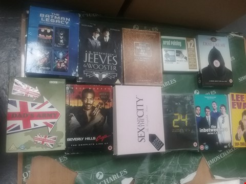 Lot 12077 A BOX OF APPROXIMATELY 22 ASSORTED DVD/BOXSETS TO INCLUDE THE BATMAN LEGACY SET AND A LEE EVANS DVD