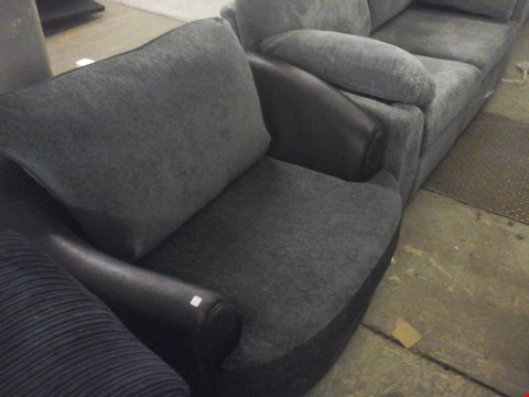 Lot 60 DESIGNER BLACK FABRIC SWIVEL CHAIR
