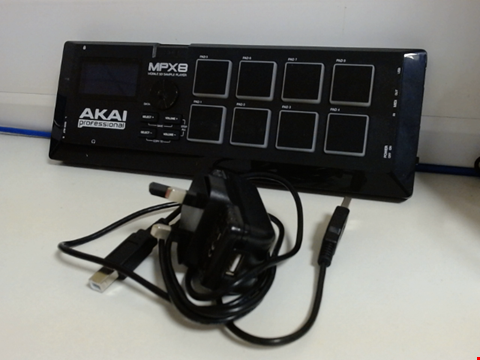 Lot 15220 AKAI PROFESSIONAL MPX8 - PORTABLE SAMPLE PAD CONTROLLER WITH 8 PERFORMANCE-READY VELOCITY-SENSITIVE PADS, MIDI CONNECTIVITY & ON-BOARD SD CARD SLOT