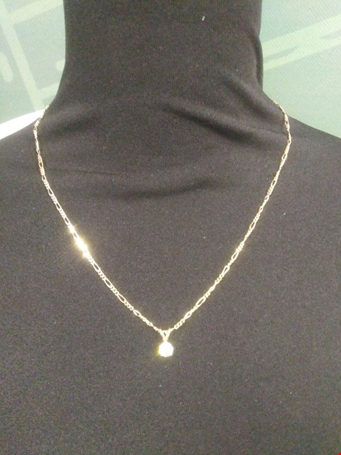 Lot 5 18CT GOLD PENDANT ON CHAIN SET WITH A DIAMOND WEIGHING +0.50CT RRP £1875.00
