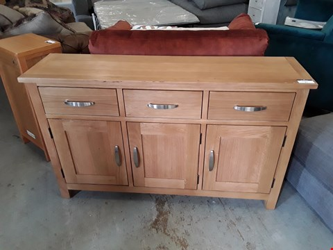 Lot 31 DESIGNER OAK EFFECT 3 DRAWER, 3 DOOR SIDEBOARD