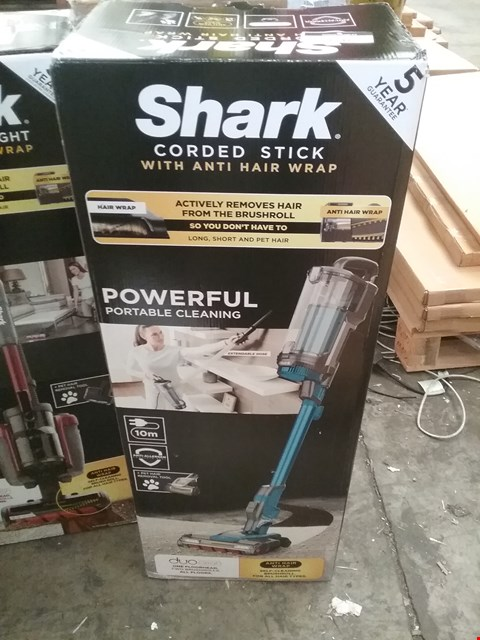 Lot 9215 BOXED SHARK CORDED STICK WITH ANTI HAIR WRAP