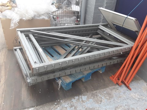 Lot 2130 LOT OF 5 ASSORTED PALLETS AND TROLLEYS CONTAINING VARIOUS METAL STORAGE RACKING COMPONENTS