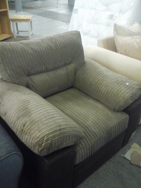 Lot 63 DESIGNER CORDED BROWN FABRIC ARMCHAIR