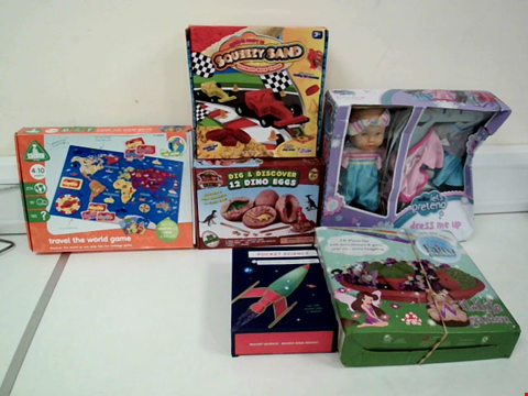 Lot 8079 LOT OF 6 ASSORTED TOYS TO INCLUDE ELC TRAVEL THE WORLD GAME, PREHISTORIC WORLD DIG & DISCOVER 12 DINO EGGS AND LET'S PRETEND DRESS ME UP BABY DOLL