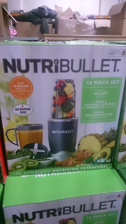 Lot 1027 FIVE  BOXED NUTRIBULLET NUTRITION EXTRACTORS.