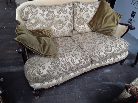 Lot 5005 DESIGNER CARVED WOOD FRAMED TWO SEATER SOFA, UPHOLSTERED IN GOLD FLORAL FABRIC, ON CABRIOLE FEET.