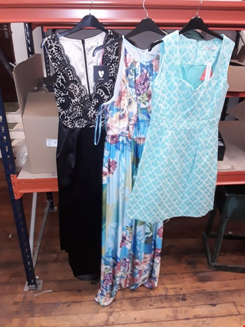 Lot 12 A BOX OF APPROXIMATELY 8 ASSORTED CLOTHING ITEMS TO INCLUDE,  LADIES BLACK/NUDE DRESS , FLORAL PATTERN DRESS AND GREEN PATTERNED DRESS ETC