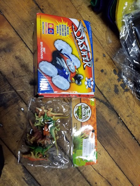 Lot 2048 A BOX OF ASSORTED ITEMS TO INCLUDE A BAG OF ASSORTED DINOSAUR MINIATURES AND A RADIO CONTROL STUNT VEHICLE