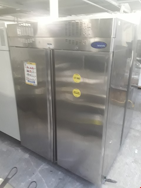 Lot 32 LARGE STAINLESS STEEL DOUBLE DOOR REFRIGERATOR