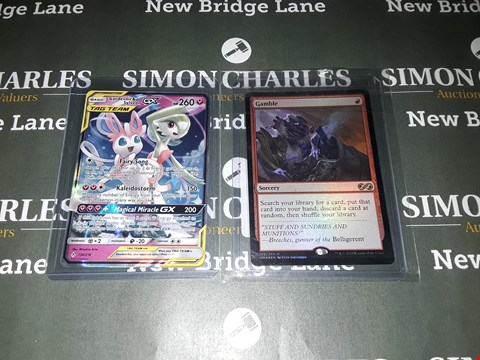 Lot 614 LOT OF 2 ASSORTED COLLECTABLE CARDS TO INCLUDE A POKEMON GARDEVOIR&SYLVEON GX TAG TEAM CARD AND A MAGIC THE GATHERING SORCERY GAMBLE CARD