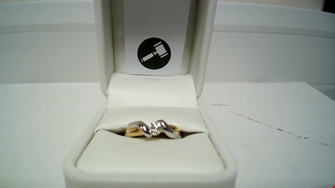Lot 1 18CT GOLD TWIST RING SET WITH A DIAMOND RRP £2100.00