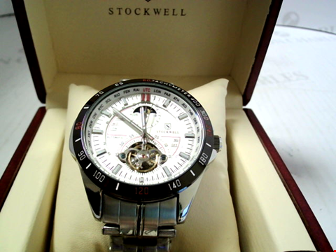 Lot 7174 DESIGNER STOCKWELL AUTOMATIC WATCH WITH MOONPHASE DIAL FOR AM/PM. GLASS BACK RRP £650.00