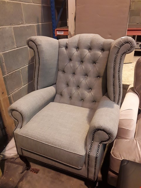 Lot 519 DESIGNER GREY FABRIC WING BACK ARMCHAIR WITH BUTTON DETAILING