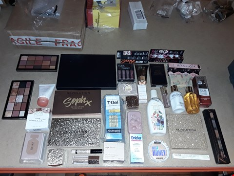 Lot 2073 BOX OF APPROXIMATELY 60 ASSORTED COSMETICS TO INCLUDE REVOLUTION LONDON MAKES EYESHADOW PALLET, OLAY REGENERIST ADVANCED ANTI-AGEING CREAM, HUDABEAUTY LIQUID MATTE MINIS, ECT (BOX NOT INCLUDED)