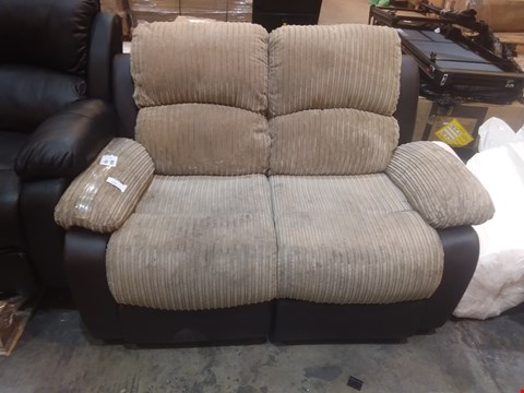 Lot 565 DESIGNER BROWN FAUX LEATHER AND BEIGE JUMBO CORD RECLINING 2 SEATER SOFA