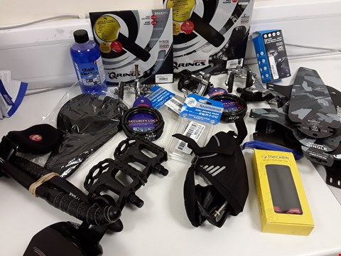 Lot 41 TRAY OF ASSORTED CYCLE ACCESSORIES & PARTS, INCLUDING, QRING CHAIN NRINGS, CHAIN CLEANER, BRAKE PARTS, SADDLE COVER, BRAKE PADS, PEDALS, BAR EXTENSIONS, SECURITY LOCKS, PHONE HOLDER, (TRAY NOT INCLUDE