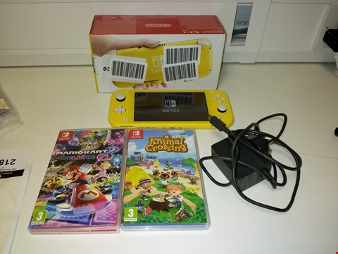 Lot 2187 NINTENDO SWITCH LITE CONSOLE - YELLOW WITH ANIMAL CROSSING NEW HORIZONS AND MARIO KART 8 SWITCH GAMES RRP £369.99