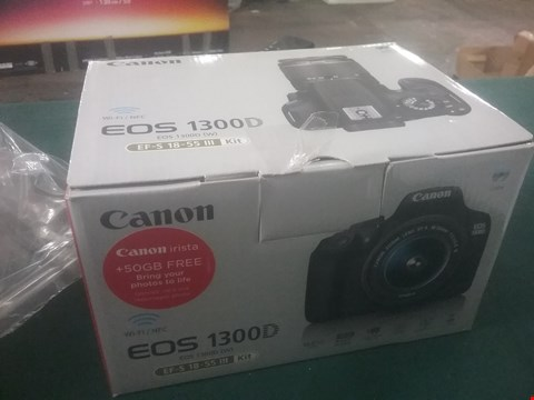 Lot 1094 BOXED GRADE 1 CANON EOS 1300D SLR KIT, INCLUDING 18-55MM DC III LENS AND A CASE RRP £509.99