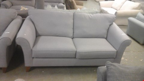 Lot 1253 DESIGNER PURPLE FABRIC 3 SEATER SOFA