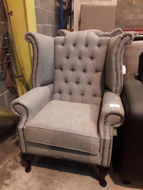 Lot 518 DESIGNER GREY FABRIC WING BACK ARMCHAIR WITH BUTTON DETAILING