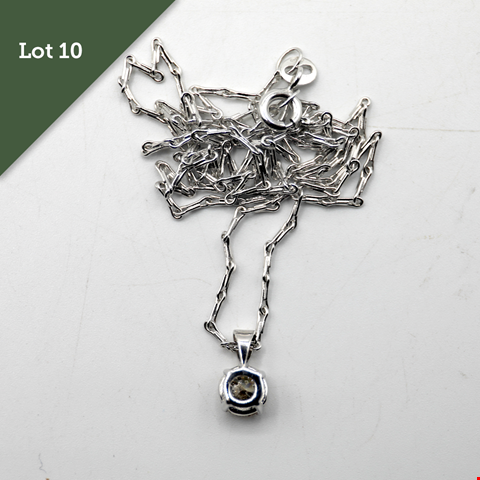 Lot 10 18CT WHITE GOLD PENDANT ON CHAIN SET WITH A DIAMOND WEIGHING +0.62CT RRP £2175.00