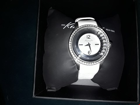 Lot 176 DESIGNER KENNETH COLE NEW YORK LADIES WRIST WATCH WITH ENCRUSTED DIAL ON WHITE LEATHER STRAP