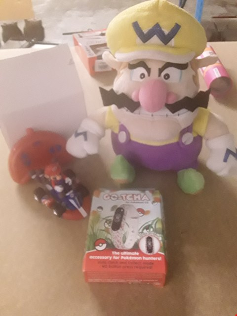 Lot 331 3 ASSORTED NINTENDO PRODUCTS TO INCLUDE; WARIO CUDDLY TOY, SUPER MARIO REMOTE CONTROL AND GO TCHA POKEMON GO BRACELET